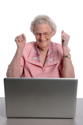 person excited at doing something on computer