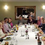 volunteers enjoying a meal together